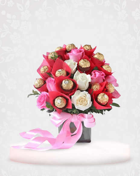 Gorgeous mix of White Roses and Ferrero Rocher Chocolates Bouquet Online